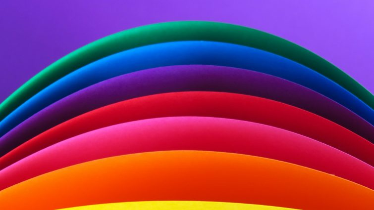 A rainbow on a purple background.